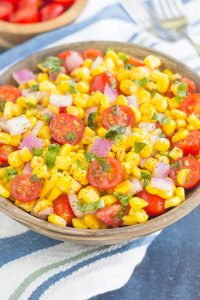 A healthy meal with tomatoes and corn